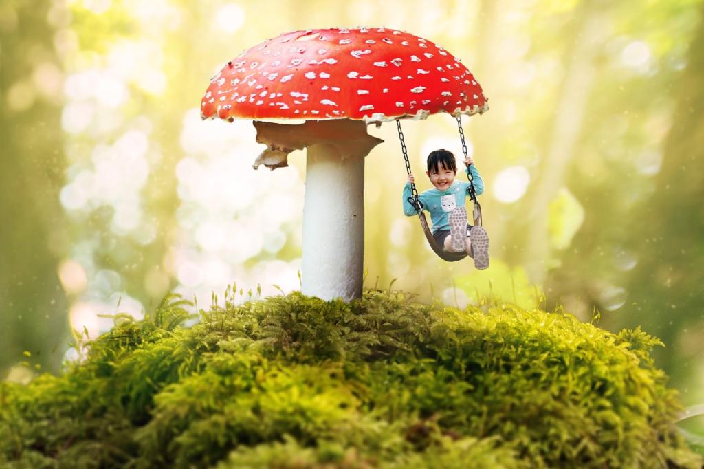 Girl on swing under mushroom