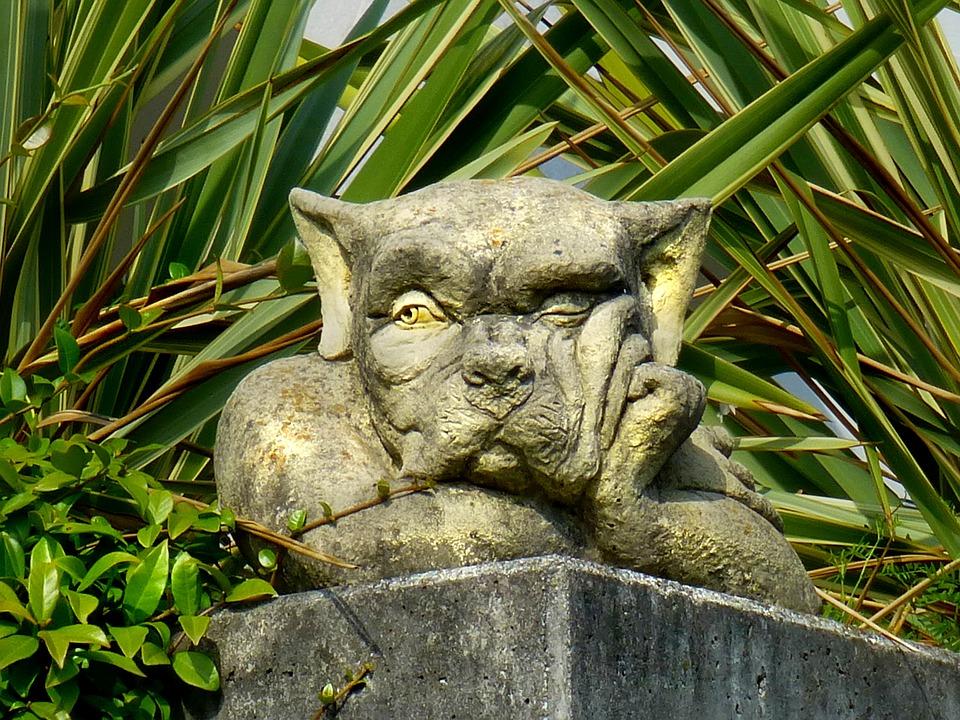 bored dog statue